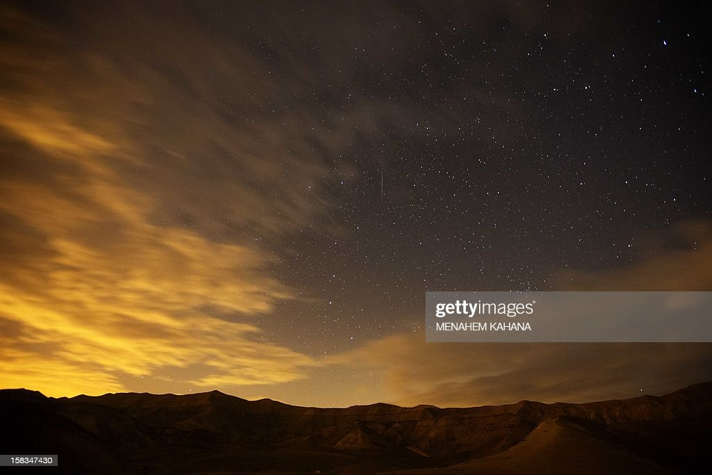 A Geminid meteor streaks are seen above the Judean desert near near the Israeli Kibbutz of Ein Gedi early December 14, 2012. The meteor display, known as the Geminid meteor shower because it appears to radiate from the constellation Gemini, is thought to be the result of debris cast off from an asteroid-like object called 3200 Phaethon. The shower is visible every December.