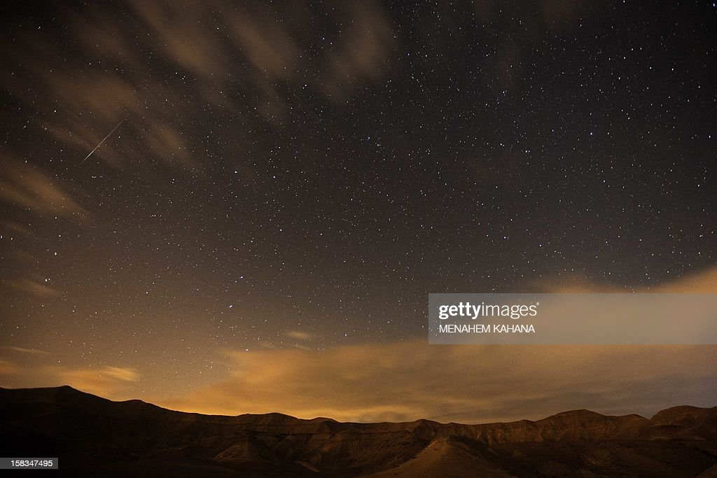 Geminid meteor streaks are seen above the Judean desert near the Israeli Kibbutz of Ein Gedi early December 14, 2012. The meteor display, known as the Geminid meteor shower because it appears to radiate from the constellation Gemini, is thought to be the result of debris cast off from an asteroid-like object called 3200 Phaethon. The shower is visible every December.