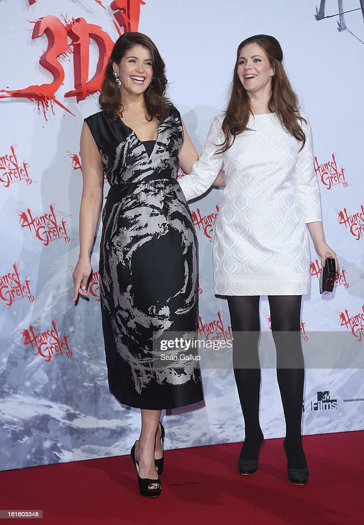 Gemma Arterton (L) and Pihla Viitala attend the German premiere of 'Hansel and Gretel: Witch Hunters' at the Kulturbrauerei on February 12, 2013 in Berlin, Germany.