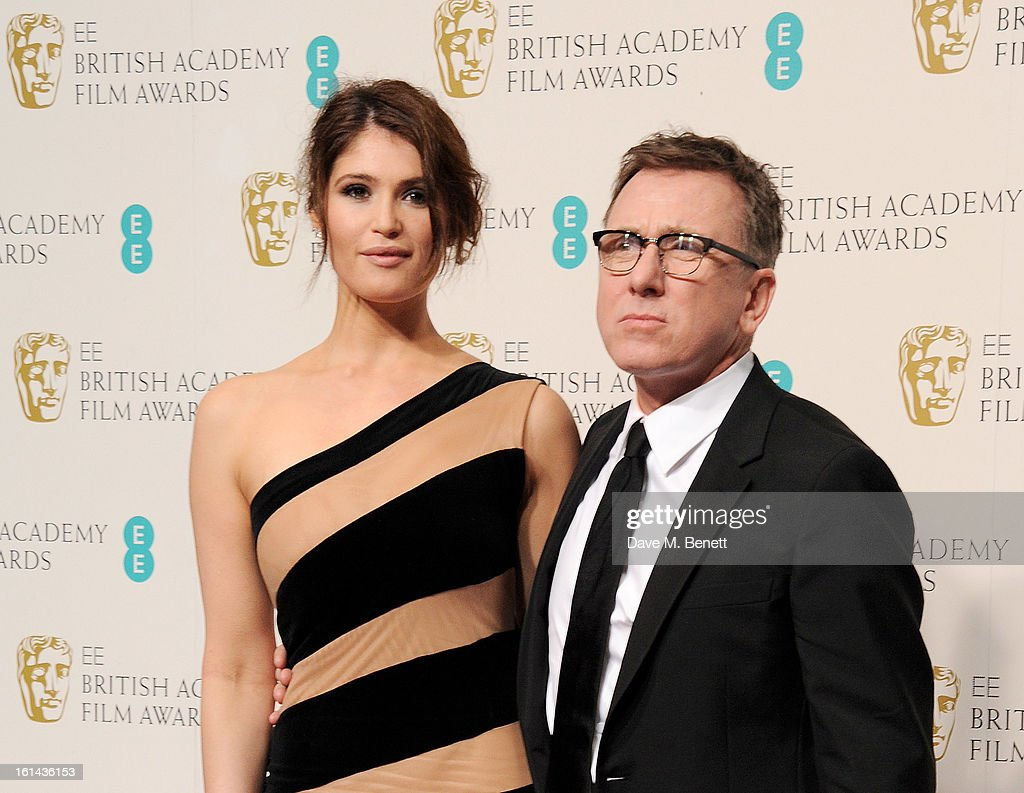Gemma Arterton (L) and Tim Roth pose in the Press Room at the EE British Academy Film Awards at The Royal Opera House on February 10, 2013 in London, England.