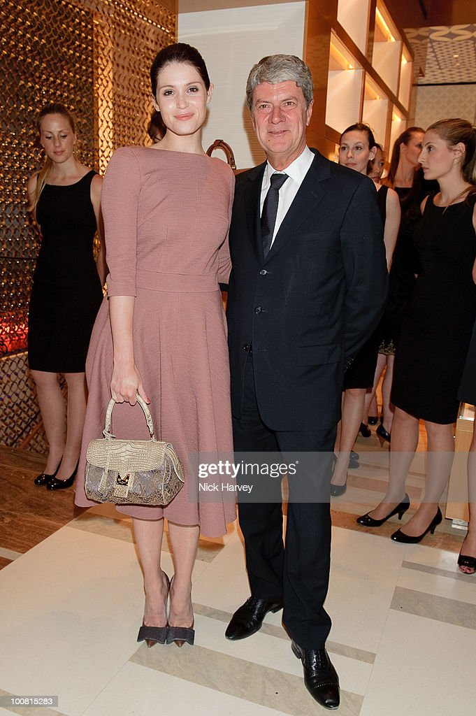 Gemma Arterton and Yves Carcelle attend the launch of the Louis Vuitton Bond Street Maison on May 25 2010 in London England