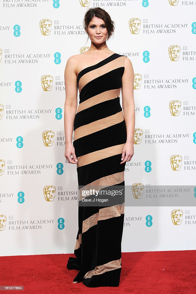 Gemma Arterton poses in the press room at The EE British Academy Film Awards 2013 at The Royal Opera House on February 10, 2013 in London, England.
