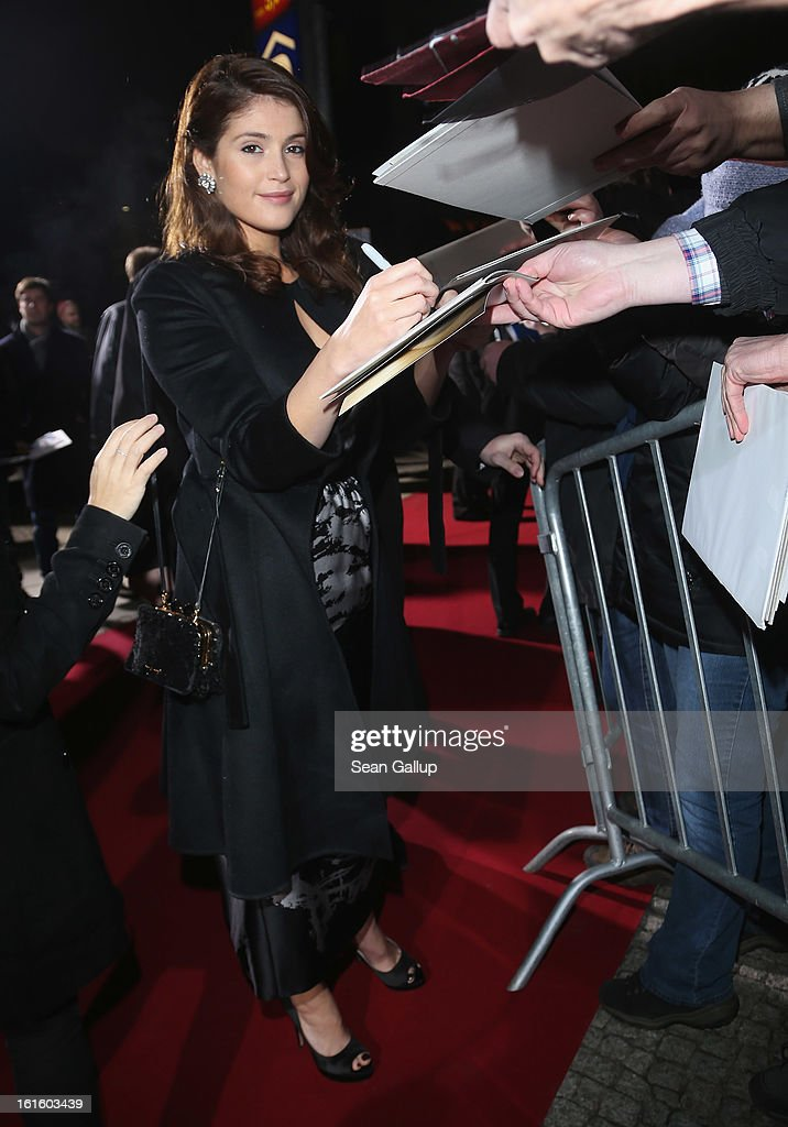 Gemma Arterton signs autographs for fans as she attends the German premiere of 'Hansel and Gretel: Witch Hunters' at the Kulturbrauerei on February 12, 2013 in Berlin, Germany.