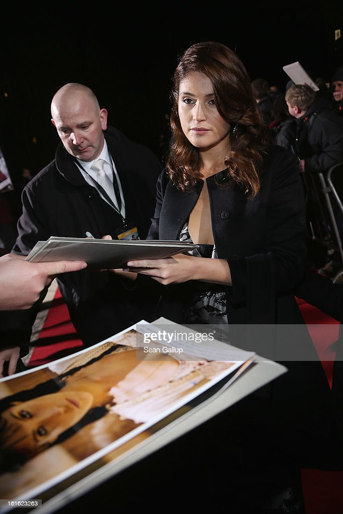 <a gi-track='captionPersonalityLinkClicked' href=/galleries/search?phrase=Gemma+Arterton&family=editorial&specificpeople=4296305 ng-click='$event.stopPropagation()'>Gemma Arterton</a> signs autographs for fans as she attends the German premiere of 'Hansel and Gretel: Witch Hunters' at the Kulturbrauerei on February 12, 2013 in Berlin, Germany.