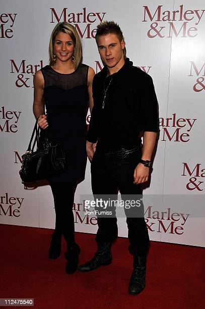Gemma Atkinson and guest arrives at the UK premiere of Marley Me at the Vue Leicester Square on March 2 2009 in London England