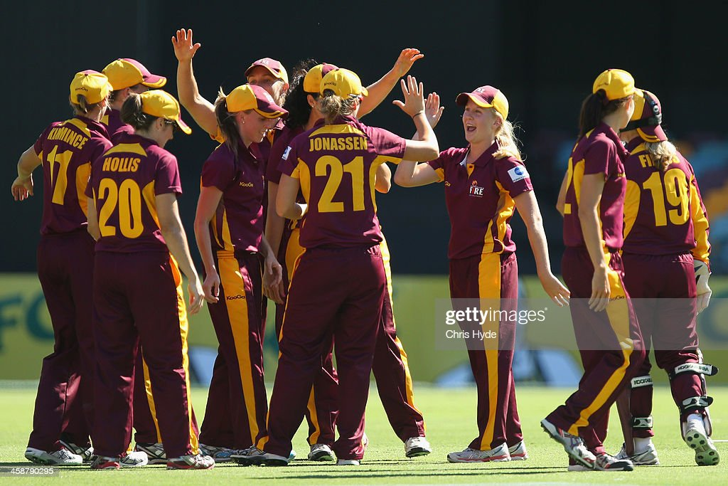 Gemma Barsby of the Fire celebrates a wicket with team mates during the WT20 match between Queensland Fire and the ACT Metoers at The Gabba on...
