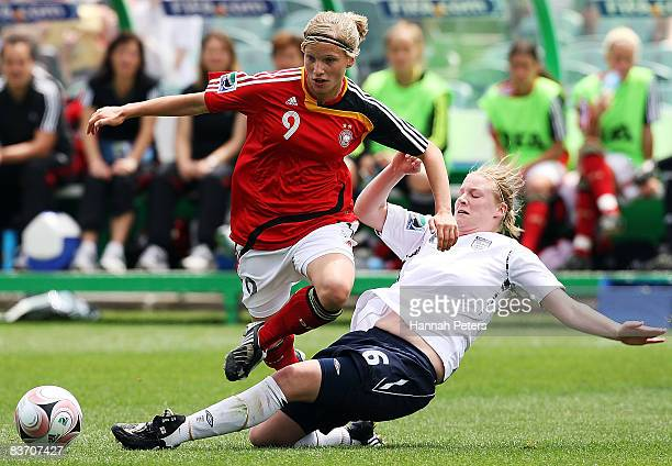 Gemma Bonner of England tackles Tabea Kemme of Germany during the FIFA U17 Women's World Cup Third and Fourth Playoff match between England and...