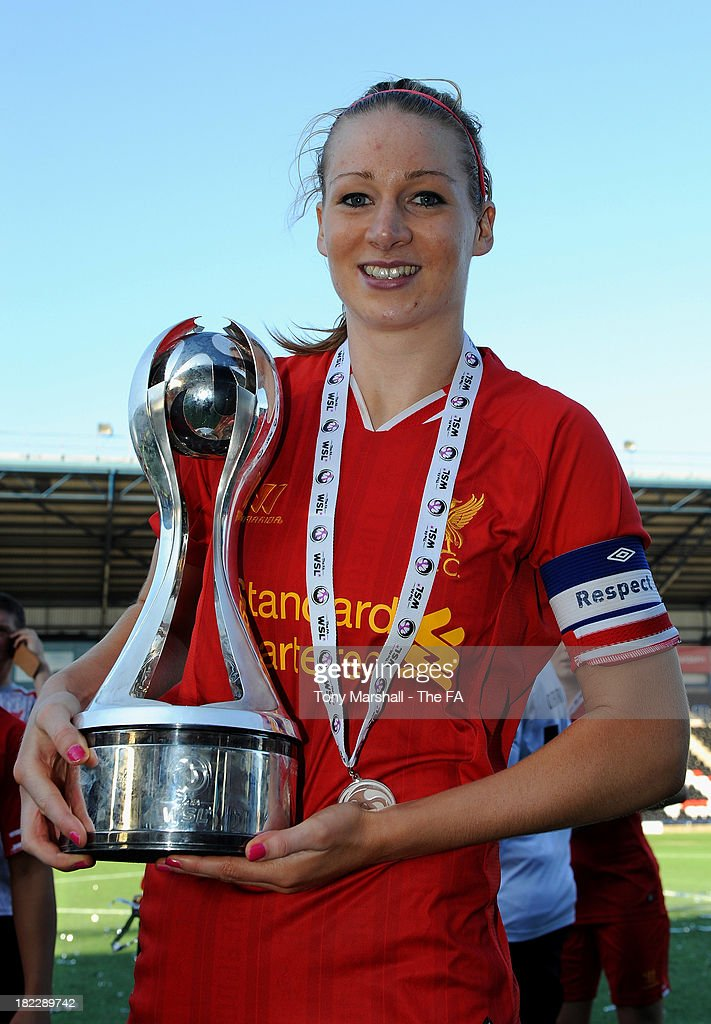 Gemma Bonner of Liverpool celebrates with the trophy after Liverpool win the FA Women's Super League during the Women's Super League match between Liverpool Ladies FC and Bristol Acadamy Women's FC at Halton Stadium on September 29, 2013 in Widnes, England.