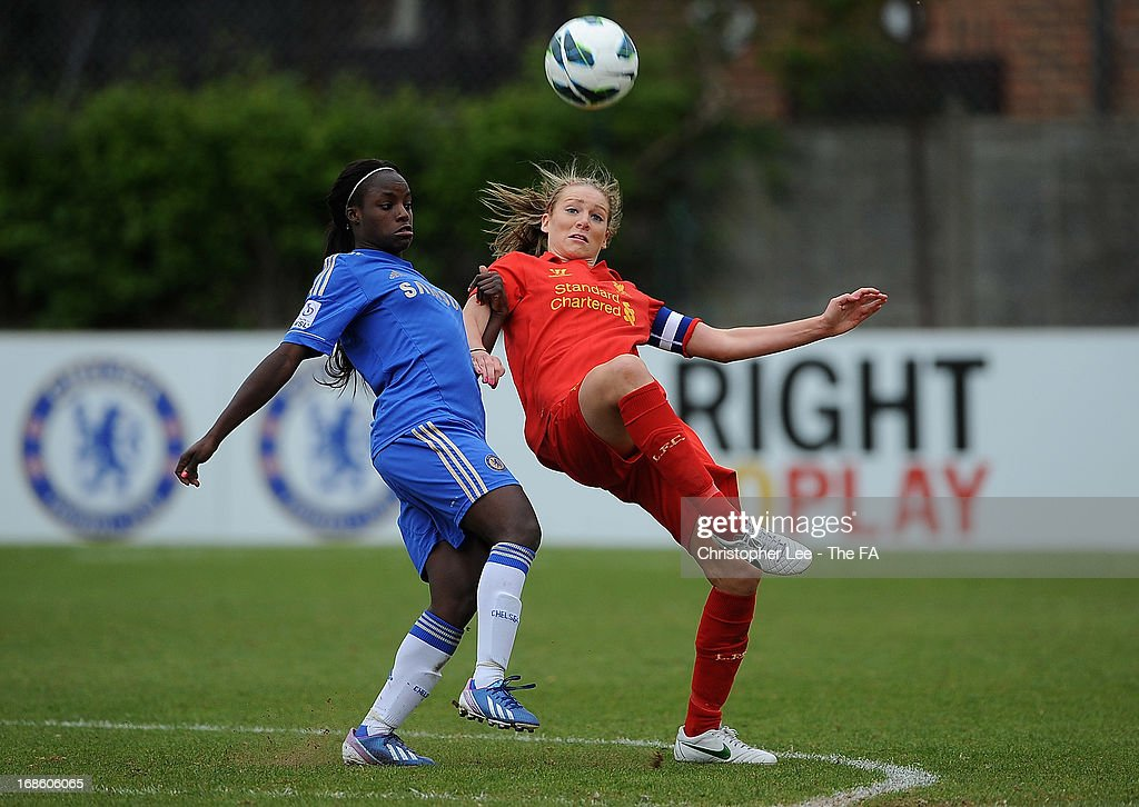 Gemma Bonner of Liverpool goes for the ball with <a gi-track='captionPersonalityLinkClicked' href=/galleries/search?phrase=Eniola+Aluko&family=editorial&specificpeople=234686 ng-click='$event.stopPropagation()'>Eniola Aluko</a> of Chelsea during the FA WSL match batween Chelsea Ladies FC and Liverpool Ladies FC at Wheatsheaf Park on May 12, 2013 in Staines, England.
