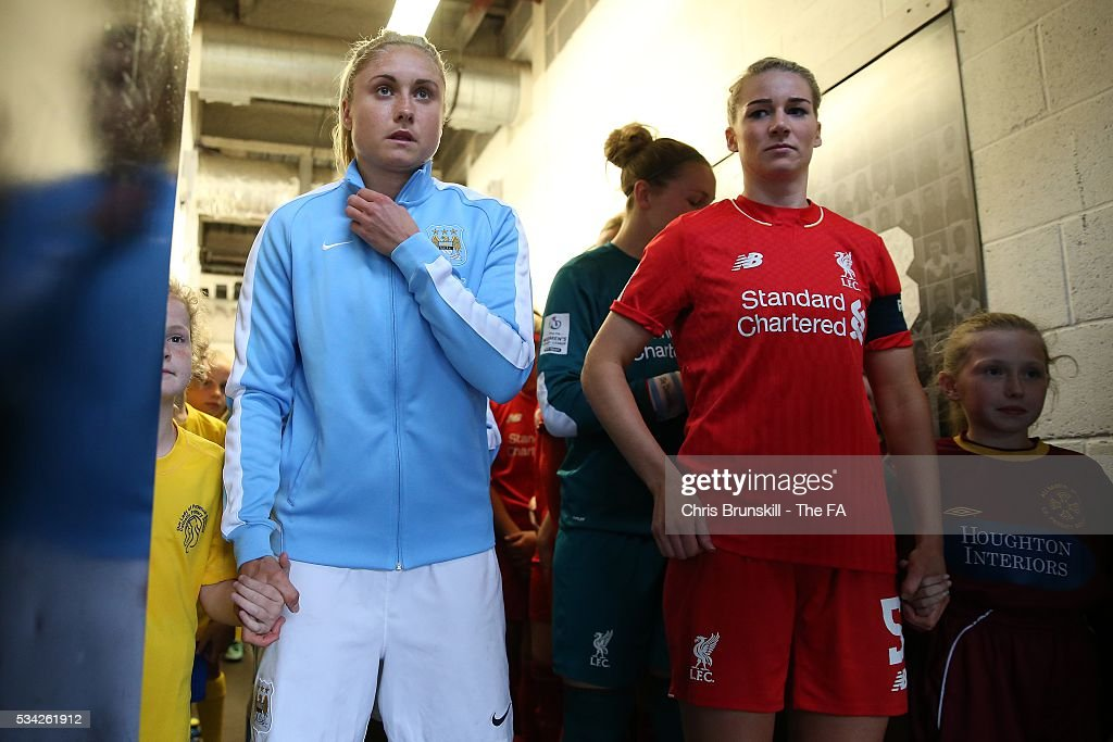 Gemma Bonner of Liverpool Ladies FC and Steph Houghton of Manchester City Women wait in the tunnel ahead of the FA WSL match between Liverpool Ladies FC and Manchester City Women at the Halton Stadium on May 25, 2016 in Widnes, England.