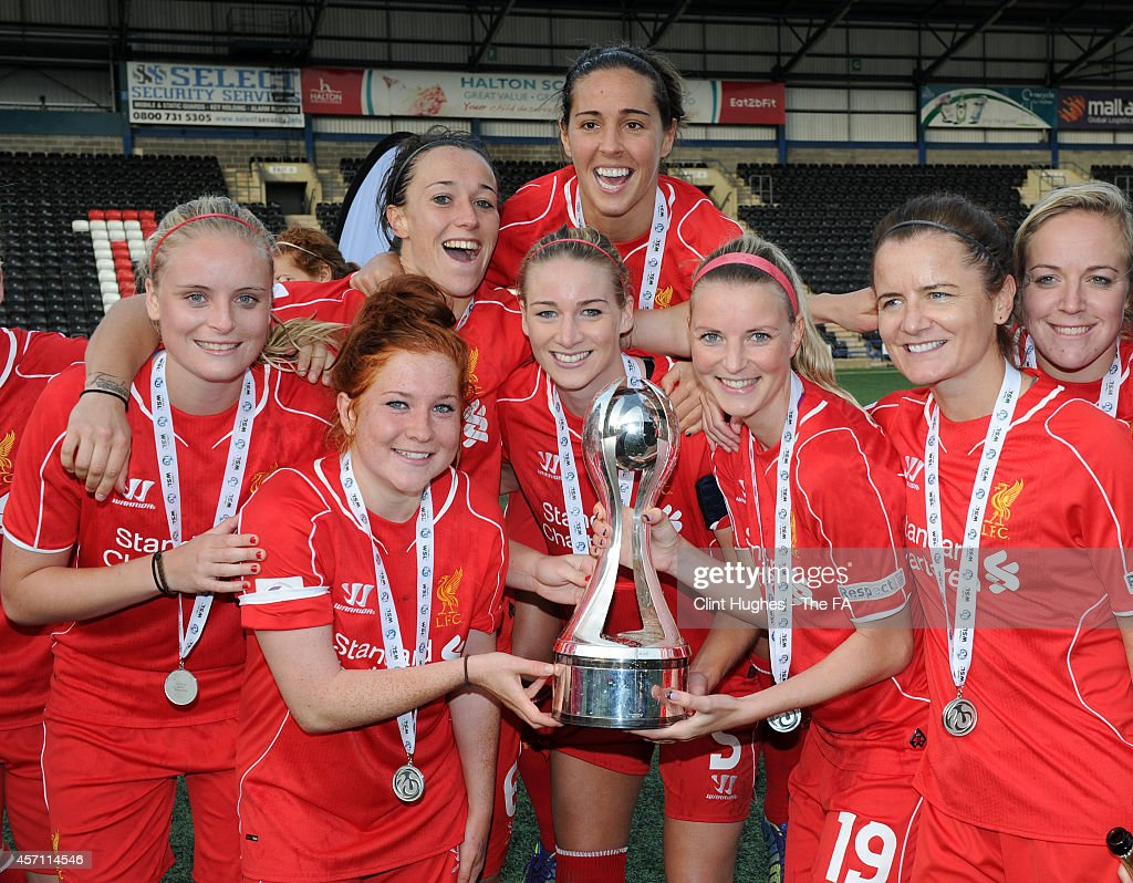 Gemma Bonner of Liverpool Ladies FC celebrates with her teammates and the WSL trophy up after her sides victory during the FA WSL 1 match between...