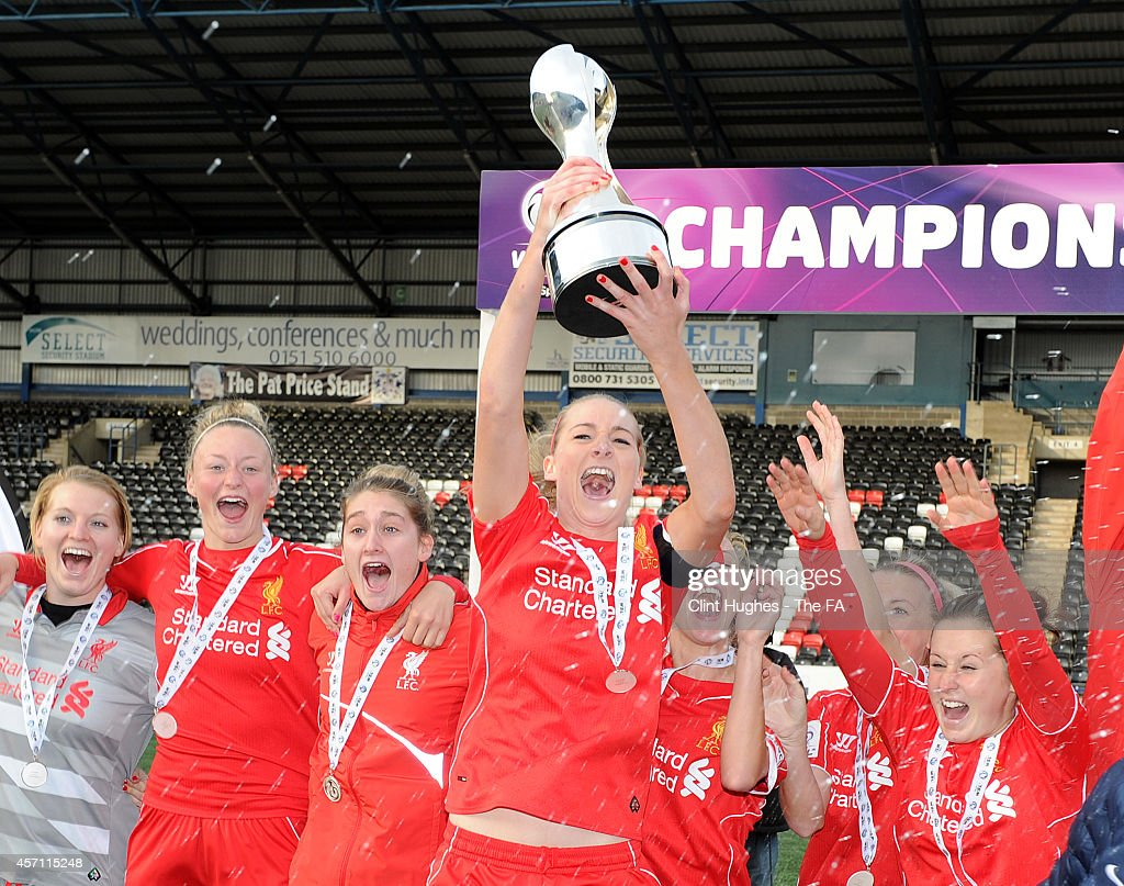 Gemma Bonner of Liverpool Ladies FC celebrates with the WSL trophy up after her sides victory during the FA WSL 1 match between Liverpool Ladies FC...