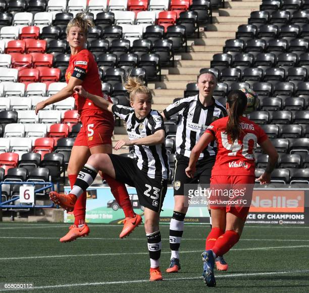 Gemma Bonner of Liverpool Ladies heads the ball down to team mate Natasha Harding challenged by Laura Bassett and Louise Quinn of Notts County Ladies...