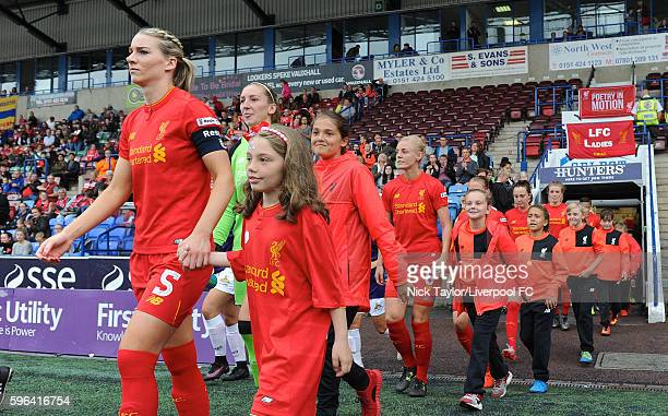 Gemma Bonner of Liverpool Ladies leads her team out on to the pitch for the start of the Liverpool Ladies v Doncaster Rovers Belles WSL 1 match on...