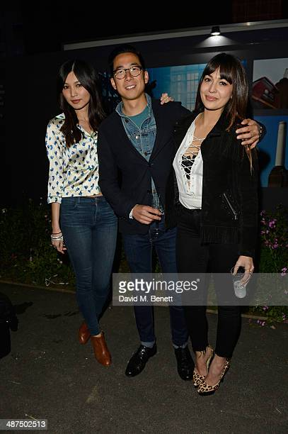 Gemma Chan guest and Zara Martin attend the Battersea Power Station Annual Party on April 30 2014 in London England