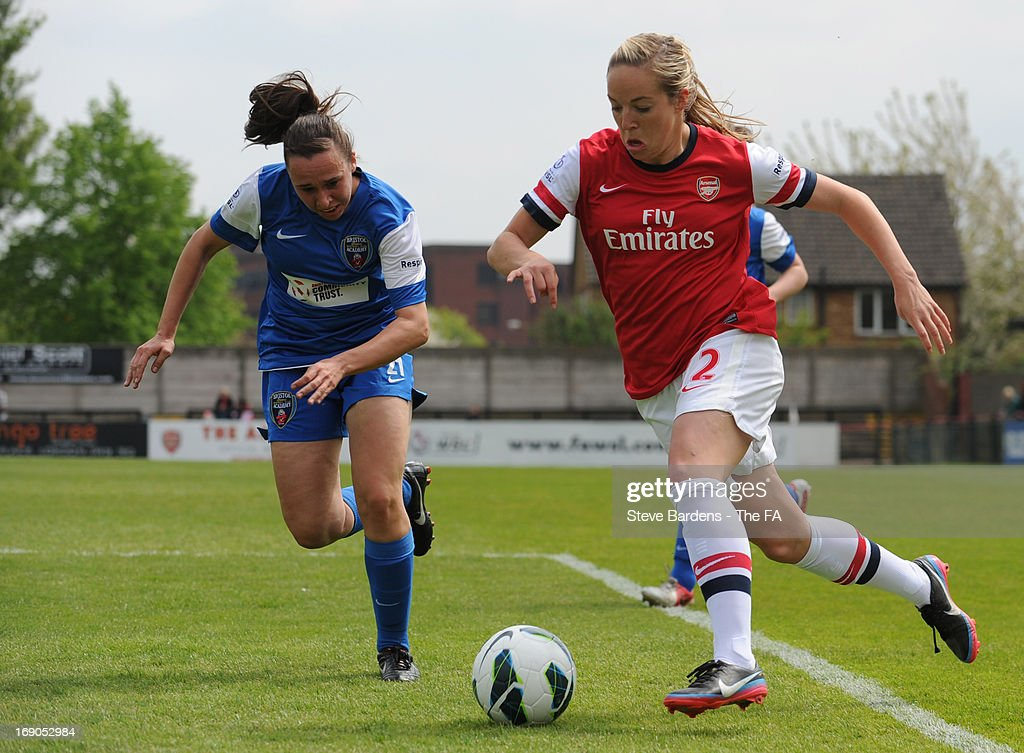 Gemma Davison of Arsenal Ladies FC breaks away from Rhian Cleverly of Bristol Academy Women's FC in action during the FA WSL Continental Cup match between Arsenal Ladies FC and Bristol Academy at Meadow Park on May 19, 2013 in Borehamwood, England.