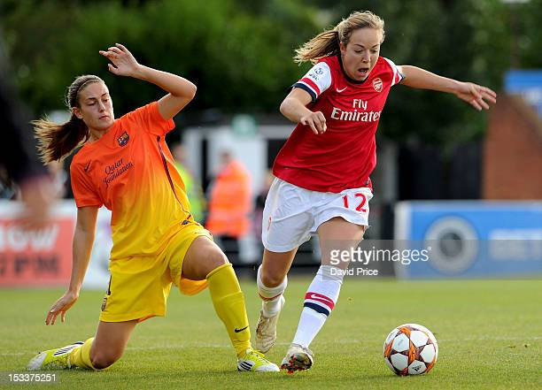 Gemma Davison of Arsenal Ladies FC takes on Alexia Putellas of Barcelona during the Women's Champions League Round of 32 match between Arsenal Ladies...