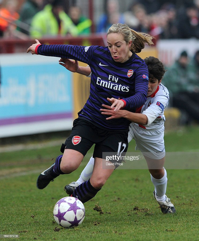 Gemma Davison (L) of Arsenal Ladies FC takes on Elisa Bartoli of Torres during the Women's Champions League Quarter Final match between Arsenal Ladies FC and ASD Torres CF at Meadow Park on March 20, 2013 in Borehamwood, United Kingdom.