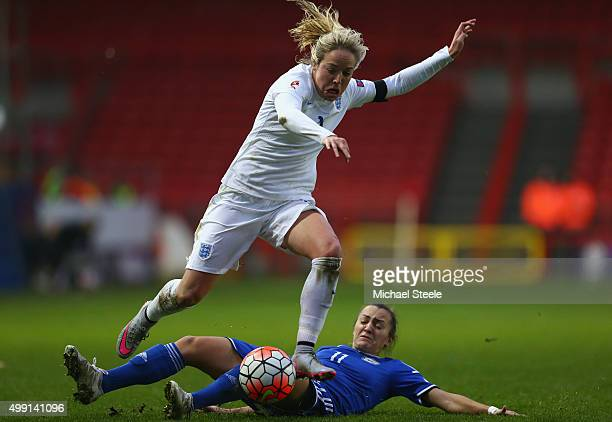 Gemma Davison of England hurdles a challenge from Lidija Kulis of Bosnia and Herzegovina during the UEFA Women's Euro 2017 Qualifier match between...