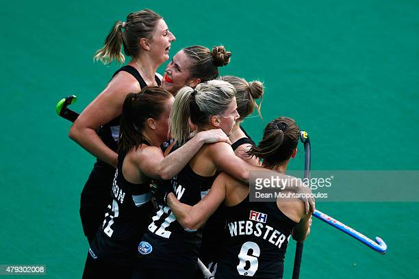 Gemma Flynn of New Zealand is congratulated by team mates after scoring a goal during the Fintro Hockey World League SemiFinal match between South...