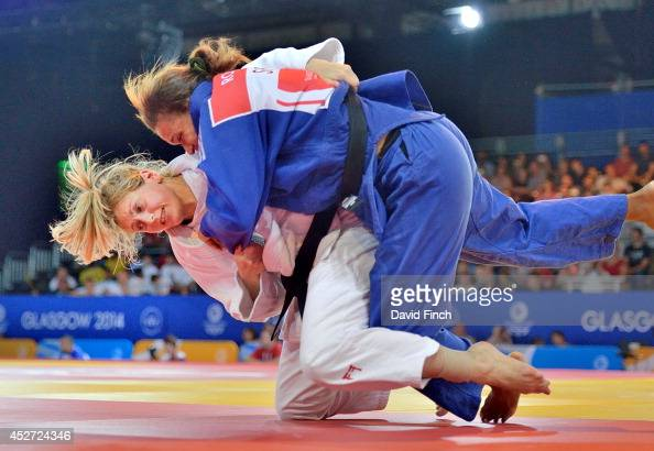 Gemma Gibbons of England throws Brigette Rose of Seychelles for ippon on her way to the u78kg final during the Commonwealth Games Judo Championships...