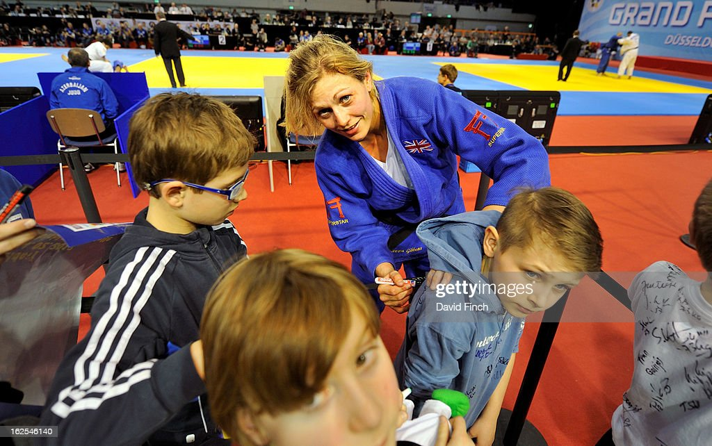<a gi-track='captionPersonalityLinkClicked' href=/galleries/search?phrase=Gemma+Gibbons&family=editorial&specificpeople=7541729 ng-click='$event.stopPropagation()'>Gemma Gibbons</a> of Great Britain autographing the clothing of young judo during Day 2 of the Dusseldorf Grand Prix at the Mitsubishi Electric on February 24, 2013 in Halle, Dusseldorf, Germany.