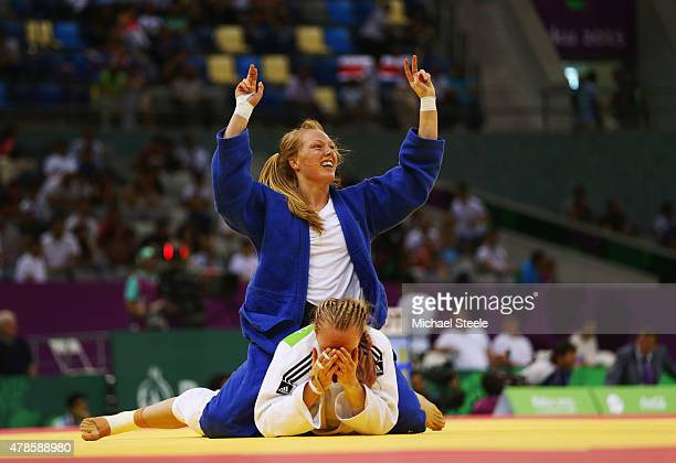 Gemma Howell of Great Britain reacts as Mia Hermansson of Sweden celebrates victory in the Women's Judo 63kg elimination round of 16 contest during...