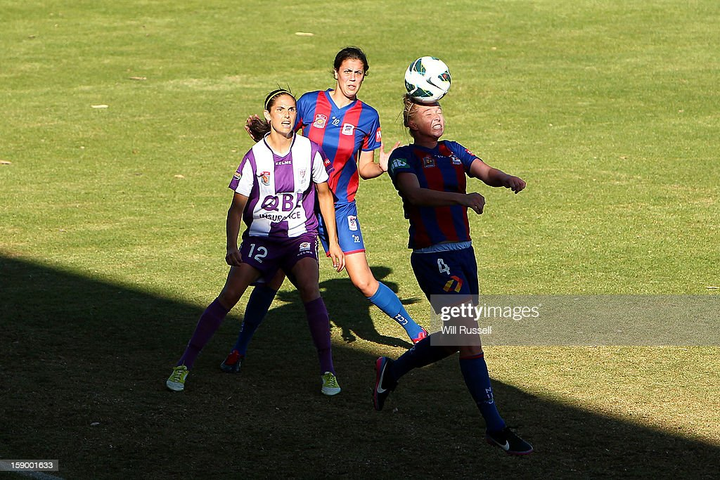 Gemma Pearce of the Jets heads the ball during the round 11 W-League match between the Perth Glory and the Newcastle Jets at Intiga Stadium on January 5, 2013 in Perth, Australia.