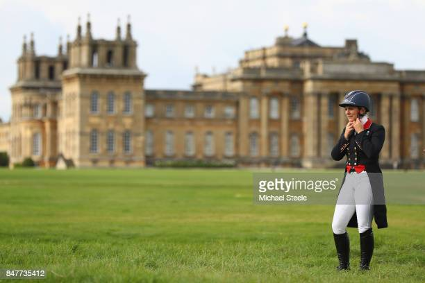Gemma Tattersall of Great Britain adjusts her helmet ahead of competition during the dressage discipline on day two of the Blenheim Palace...