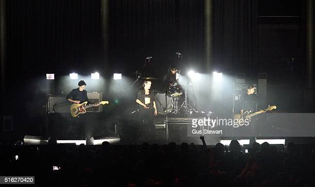Gemma Thompson Jehnny Beth Fay Milton and Ayse Hassan of Savages perform on stage at The Roundhouse on March 17 2016 in London England