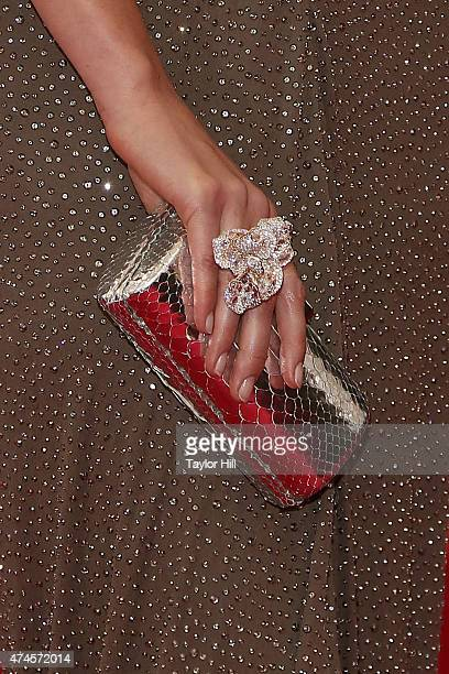 Gemma Ward clutch detail attends 'China Through the Looking Glass' the 2015 Costume Institute Gala at Metropolitan Museum of Art on May 4 2015 in New...