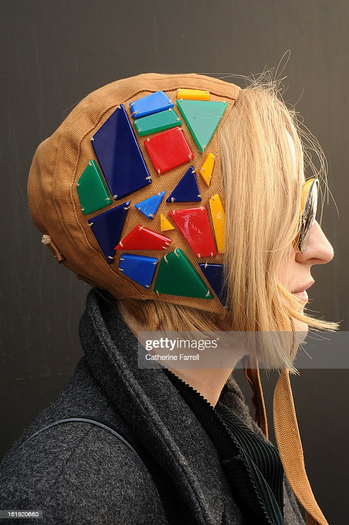 Gemma Williams Fashion curator of London College of Fashion,wears J Smith Esquire bonnet style cap with coloured shapes at London Fashion Week Fall/Winter 2013/14 on February 17, 2013 in London, England.