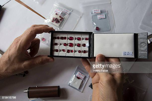 A gemmologist examines a collection of Mogok rubies