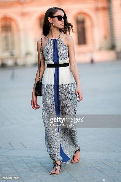 Gemmy Quelliz is wearing Prada sunglasses a vintage dress and a Chanel bag at the Louvre on August 16 2016 in Paris France