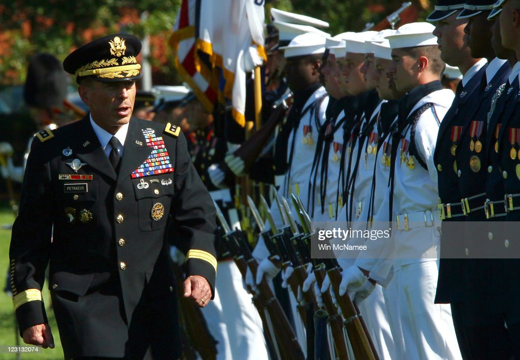 U.S. Gen. <a gi-track='captionPersonalityLinkClicked' href=/galleries/search?phrase=David+Petraeus&family=editorial&specificpeople=175826 ng-click='$event.stopPropagation()'>David Petraeus</a> (L) inspects troops during an Armed Forces Farewell Tribute and Retirement Ceremony August 31, 2011 at Ft. Myer, Virginia. Petraeus is leaving the U.S. Army after 37 years in the service to serve as the new Director of the Central Intelligence Agency.