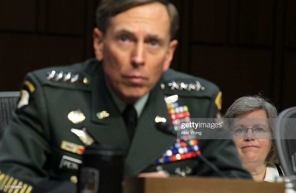 U.S. Gen. <a gi-track='captionPersonalityLinkClicked' href=/galleries/search?phrase=David+Petraeus&family=editorial&specificpeople=175826 ng-click='$event.stopPropagation()'>David Petraeus</a> (L) listens as his wife <a gi-track='captionPersonalityLinkClicked' href=/galleries/search?phrase=Holly+Petraeus&family=editorial&specificpeople=7072878 ng-click='$event.stopPropagation()'>Holly Petraeus</a> (R) looks on during a confirmation hearing before the Senate (Select) Intelligence Committee June 23, 2011 on Capitol Hill in Washington, DC. Gen. Petraeus will become the director of the Central Intelligence Agency if confirmed.