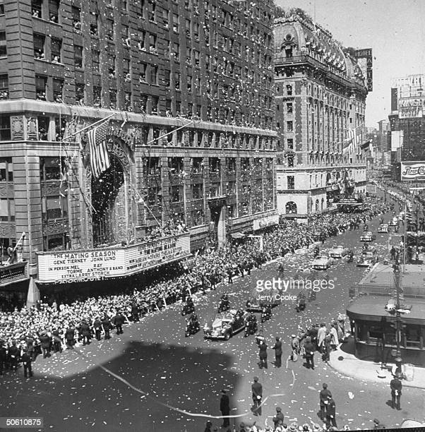 Gen Douglas MacArthur's motorcade making its way through Times square under torrent of ticker tape during welcome home parade in his honor Astor...