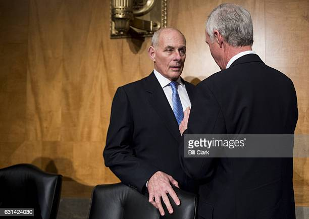 Gen John F Kelly USMC speaks with chairman Sen Ron Johnson RWisc before testifying during the Senate Homeland Security Committee hearing on his...