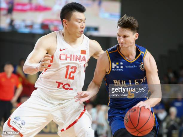Gen Li and Shaun Bruce during the match between the Brisbane Bullets and China at the Gold Coast Sports Leisure Centre on July 18 2017 in Gold Coast...