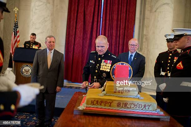 Gen Robert B Neller Commandant of the Marine Corps cuts the cake during a 240th birthday celebration for the Marines in the Russell Building as Sen...