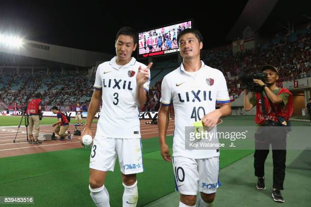 Gen Shoji and Mitsuo Ogasawara of Kashima Antlers talk after their 10 victory in the JLeague J1 match between Cerezo Osaka and Kashima Antlers at...