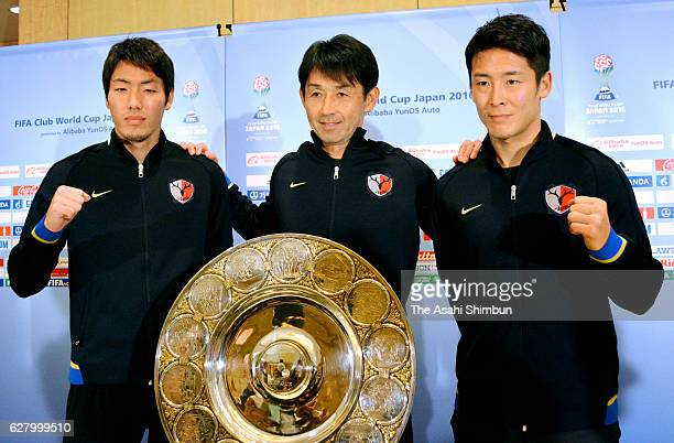 Gen Shoji head coach Masatada Ishii and Ryota Nagaki of Kashima Antlers pose for photographs during a press conference ahead of the FIFA Club World...