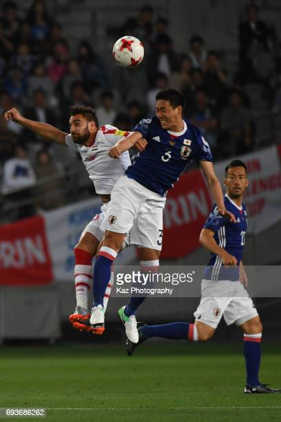 Gen Shoji of Japan and Mardek Mardkian of Syria comete for the ball by header during the international friendly match between Japan and Syria at...