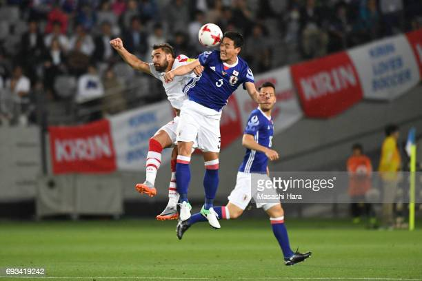 Gen Shoji of Japan and Mardek Mardkian of Syria compete for the ball during the international friendly match between Japan and Syria at Tokyo Stadium...