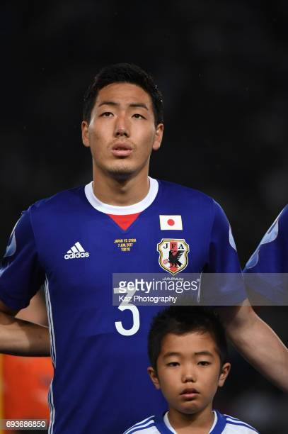 Gen Shoji of Japan Lines up for the national anthem during the international friendly match between Japan and Syria at Tokyo Stadium on June 7 2017...