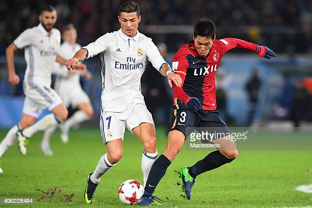 Gen Shoji of Kashima Antlers and Cristiano Ronaldo of Real Madrid compete for the ball during the FIFA Club World Cup final match between Real Madrid...