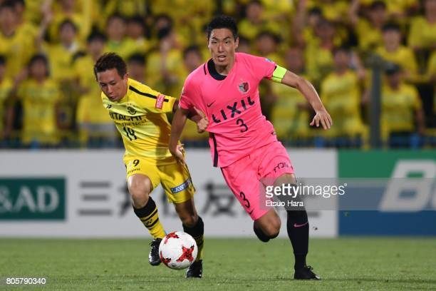 Gen Shoji of Kashima Antlers and Hiroto Nakagawa of Kashiwa Reysol compete for the ball during the JLeague J1 match between Kashiwa Reysol and...