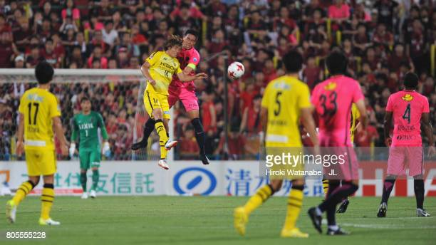 Gen Shoji of Kashima Antlers and Junya Ito of Kashiwa Reysol compete for the ball during the JLeague J1 match between Kashiwa Reysol and Kashima...