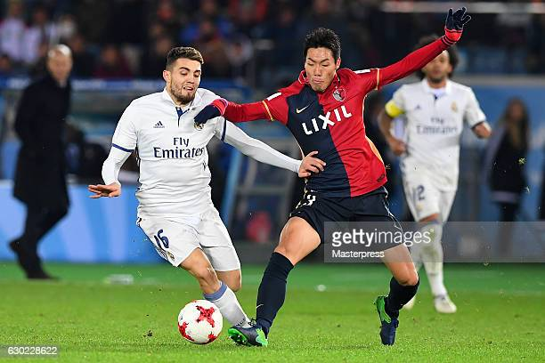 Gen Shoji of Kashima Antlers and Mateo Kovacic of Real Madrid compete for the ball during the FIFA Club World Cup final match between Real Madrid and...