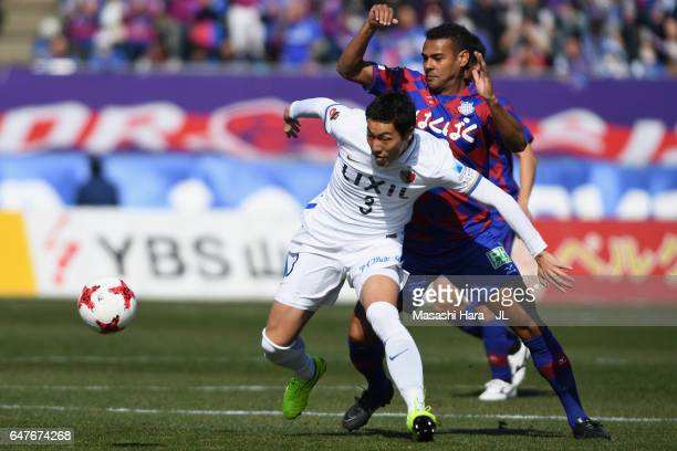 Gen Shoji of Kashima Antlers and Wilson of Ventforet Kofu compete for the ball during the JLeague J1 match between Ventforet Kofu and Kashima Antlers...